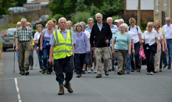 Philip Lanfranchi leading a walk for health, along with other walkers