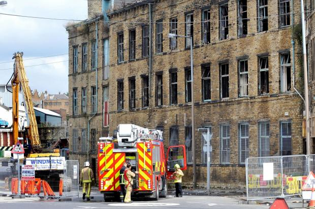 Fire department back at Mill Street mill fire after  hot spot  discovered