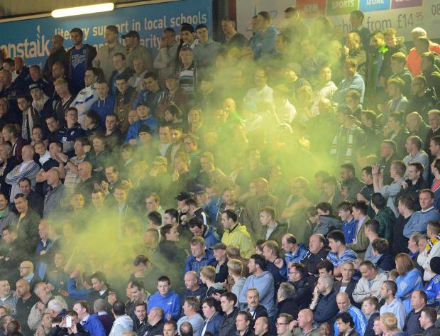 A flare is set off amongst the Leeds fans