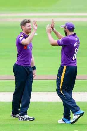 Yorkshire's Richard Pyrah, left, is congratulated by Tim Bresnan after claiming the wicket of Durham's Keaton Jennings
