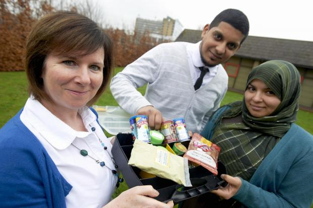 GOING ALONE: Joanne Nykol, tobacco lead for Bradford Council, with Sufyaan Mia and Raija Begum, smokeless tobacco advisors, with a selection of smokeless tobacco products