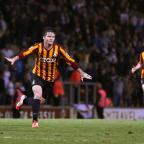 Bradford Telegraph and Argus: Billy Knott runs off in sheer ecstasy after his stunning strike in front of the Kop