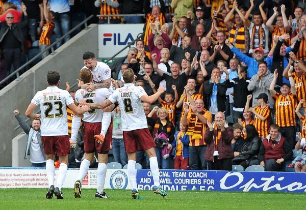GAME OVER: James Hanson celebrates in front of the jubilant army of City fans after scoring the second