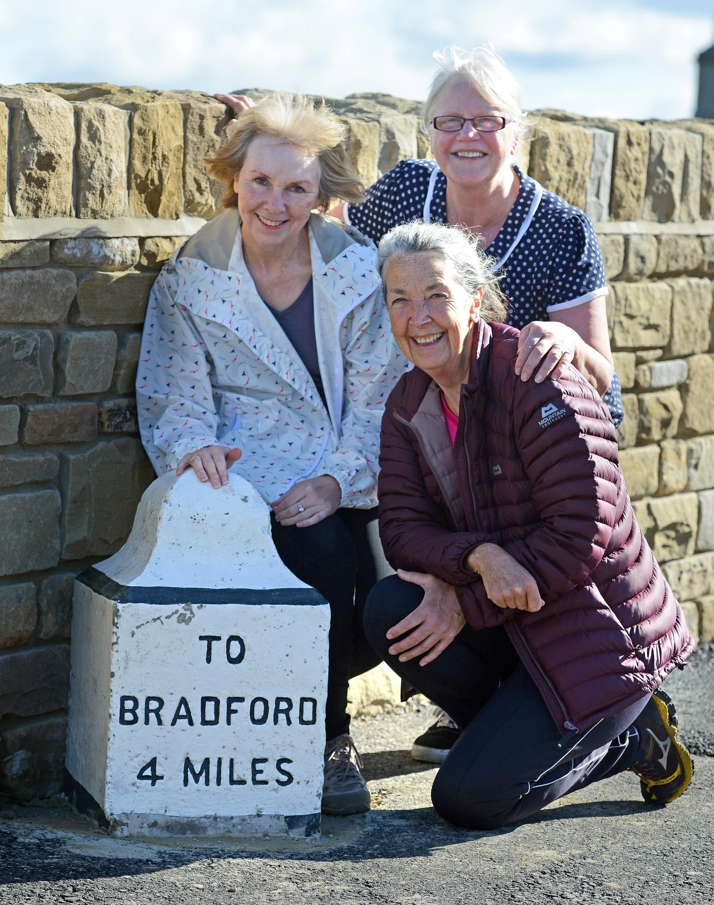Historic mile stone returned to its rightful place between Bradford and Halifax