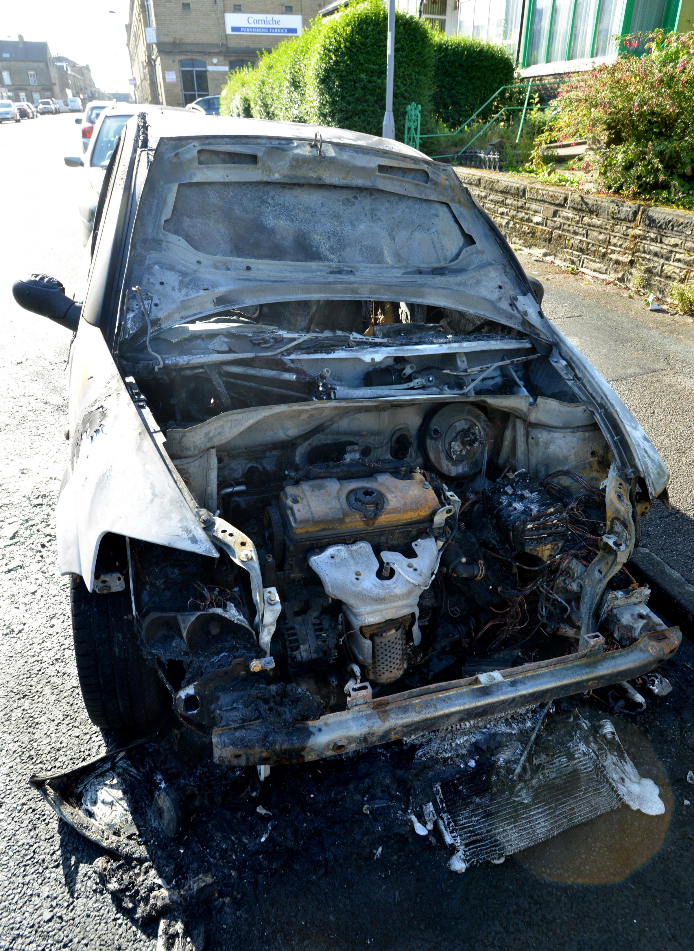 VIDEO: Families speak of their terror after fire damages three cars outside Bradford homes