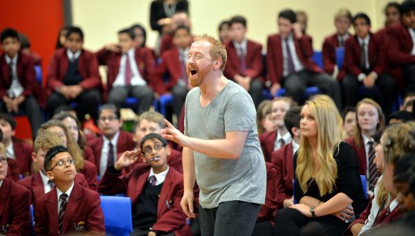 Members of the Royal Shakespeare Company perform Taming of the Shrew at Bingley Grammar school