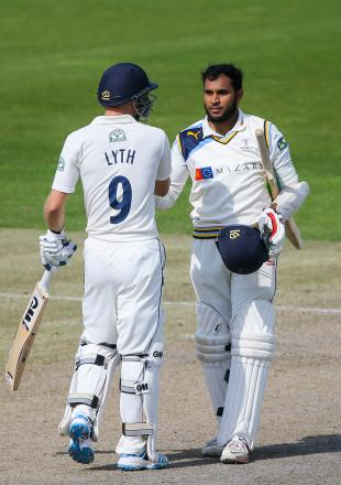 Adam Lyth and Adil Rashid celebrate reaching another milestone for Yorkshire