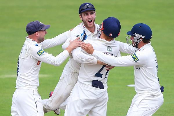 Kane Williamson, second left, is congratulated after his brilliant slip catch to dismiss Steven Croft