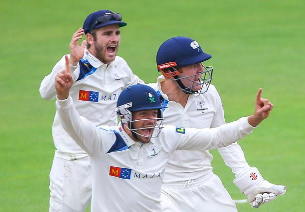 Yorkshire's Jack Leaning, Jonny Bairstow and Kane Williamson celebrate the wicket of Lancashire's Ashwell Prince