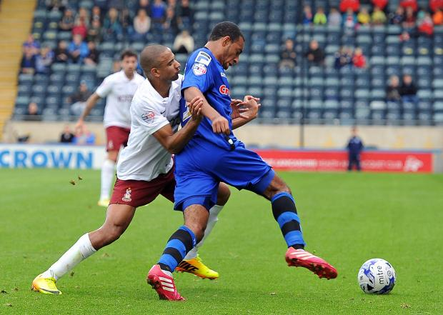 James Meredith challenges Rochdale opponent Rhys Bennett during City's last league win