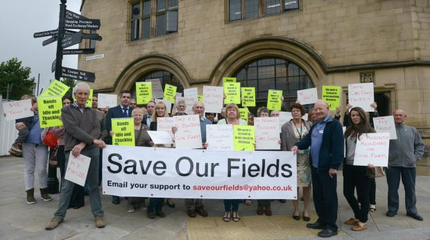 Protesters gather outside City Hall to voice their opinion on the proposed building at Cote Farm