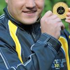 Bradford Telegraph and Argus: COURAGE: Royal Marine Liam Brentley with a medal for competing in the Invictus Games