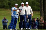 Europe's Jamie Donaldson (centre) talks tactics with Lee Westwood (right) and his caddy Billy Foster on day two of the 40th Ryder Cup