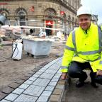 Bradford Telegraph and Argus: Chris Bedford of Bradford Council during the ongoing works replacing the stonework on Kirkgate