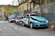 Three of the four cars damaged in suspected arson attack at Bradford autoparts business