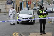 SCENE: A police officer at the scene of the incident in which Marek Benak (above) was stabbed to death