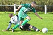 Damian Melvin of West Bowling skips past Saltaire Rangers opponent Adam Hodgson