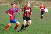 Sandy Lane's Jack Carter, left, is too late to intercept during his side's 5-0 defeat to Bingley Juniors during the GOALS Craven, Aire & Wharfe League under-18 clash