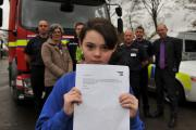 SAFETY FIRST: Isabelle Suddick, 11, a pupil at All Saints' CE Primary School (front) holding her letter with Fire, Police, Bradford Council Road Safety representatives and the Headteacher John Davie in the background.