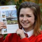 Bradford Telegraph and Argus: PLANS: Tia Clifford with a picture of the camp in Tanzania she is hoping to visit