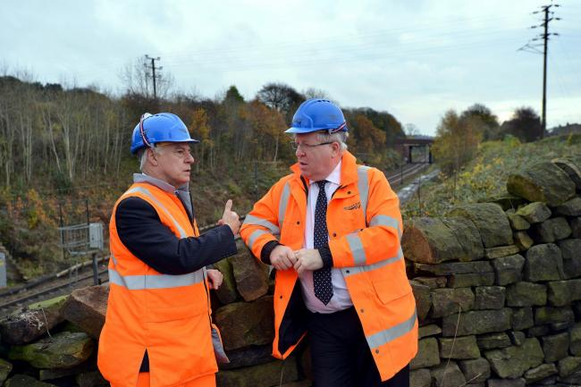 Bradford East MP David Ward (left) meets Transport Secretary Patrick McLoughlin at the construction site of Apperley Bridge station