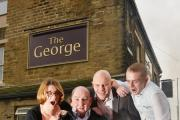 Getting ready for fundraising events at The George pub in Idle is Colin Nesbitt, of Little Heroes Cancer Trust, Sue Pullan, Craig Isaacs and Chris Langwade