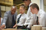 Delroy Beverley, left, with Tong School pupils during a business challenge .