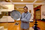 Nilesh Mistry with one of the exhibits at the new The Eye of the Beholder exhibition at Cartwright Hall Art Gallery