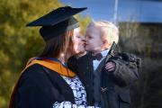 Scarlett Tetley gets a kiss from her son, Lejah, on her graduation day from Bradford College