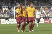 Jake Speight, middle, celebrates his penalty at Hereford in 2011 with Robbie Threlfall and James Hanson. The home side are now reduced to playing in the Southern League
