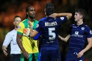 Norwich City's Cameron Jerome and Leeds United's Giuseppe Bellusci have an altercation during the Sky Bet Championship match at Carrow Road