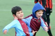 Ellis Hayhill, right, congratulates John Gazi on scoring for Bolton Woods under-eights against Bingley at Beckfoot School