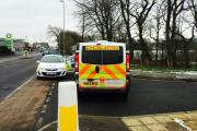Police at the scene in Guiseley following the discovery of a body