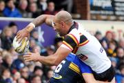 Chev Walker offloads for Bulls in the friendly with Leeds