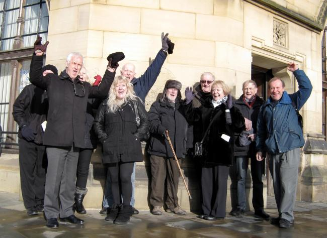 Members of Menston Action Group celebrate after the planning meeting in City Hall