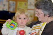 STORYTIME: Imogen McKee, aged 20 months, with Gillian Fryer at Shipley Library, which hosted a challenge