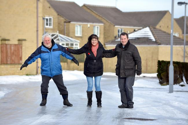 Roads in Queensbury became very dangerous last winter. Left to right are Councillor Paul Cromie and Lynda Cromie with local resident Mark Williams