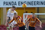 GROUNDS FOR CONCERN: Gary Liddle and Colchester striker Chris Porter clash last week at Valley Parade. The U's scorer described the pitch as the worst he had ever played on