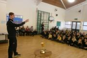 Yorkshire County Cricket Club squad member James Wainman addresses the assembly at Fearnville Primary School