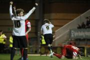 James Hanson turns to celebrate scoring with a little help from Billy Clarke – Picture: Thomas Gadd