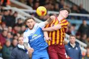 New loan signing Oliver Burke battles against a flailing arm  Pictures: Thomas Gadd