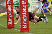 Lee Gaskell dives over for his first try of the afternoon