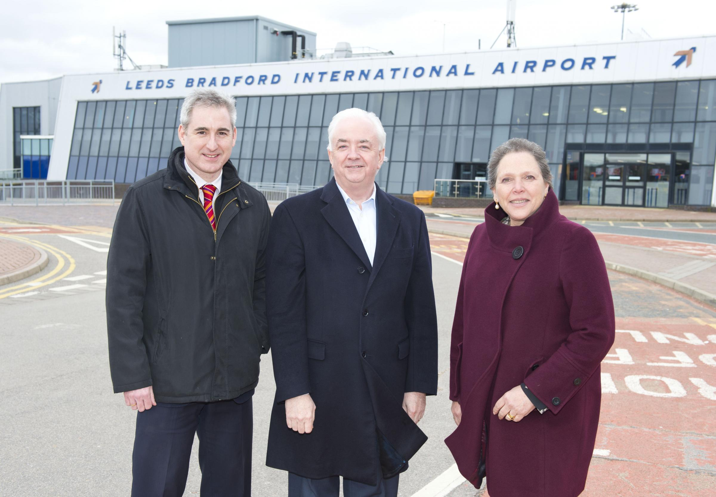 MP Greg Mulholland, John Parkin, and Baroness Kramer at Leeds Bradford Airport
