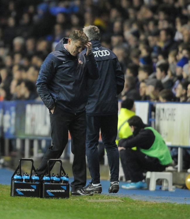 Phil Parkinson cuts a dejected figure at the Madejski but insists his City players have been