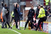 The Fleetwood bench goes mad after equalising in stoppage time; Phil Parkinson also went mad, with his players in the dressing room after Saturday's 2-2 draw