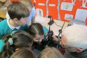 Otley Amateur Radio Society member Kevin Gallagher letting pupils at Ashfield Primary School 'listen in'