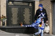 Reading fans left tributes and flowers at the memorial to the 56 people who died in the Valley Parade Fire before the recent FA Cup quarter-final