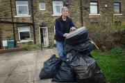 OVERFLOWING: Gloria Dallas with the rubbish outside her home which has now been collected