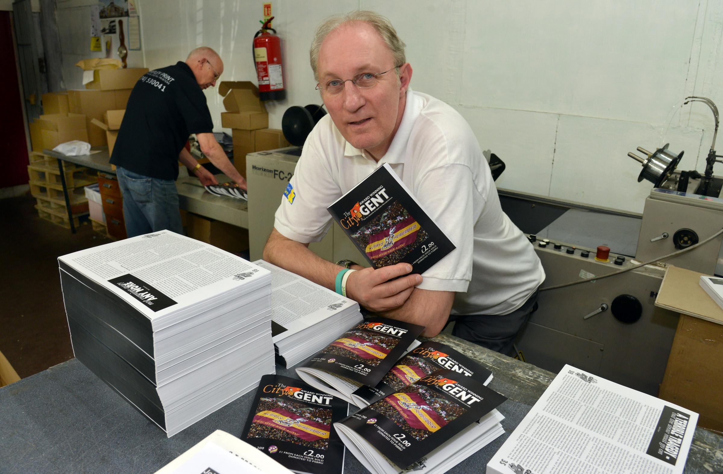 Mike Harrison, editor of the City Gent, sees the edition come off the press