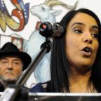 Bradford Telegraph and Argus: George Galloway, the man in the hat, looks on as Naz Shah speaks after defeating him at Bradford West
